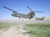 Chinook delivers an underslung supply load into Sangin District Centre